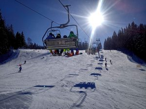 Snowboarders on Chairlift